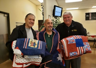 Veterans being honored with their Quilts of Valor